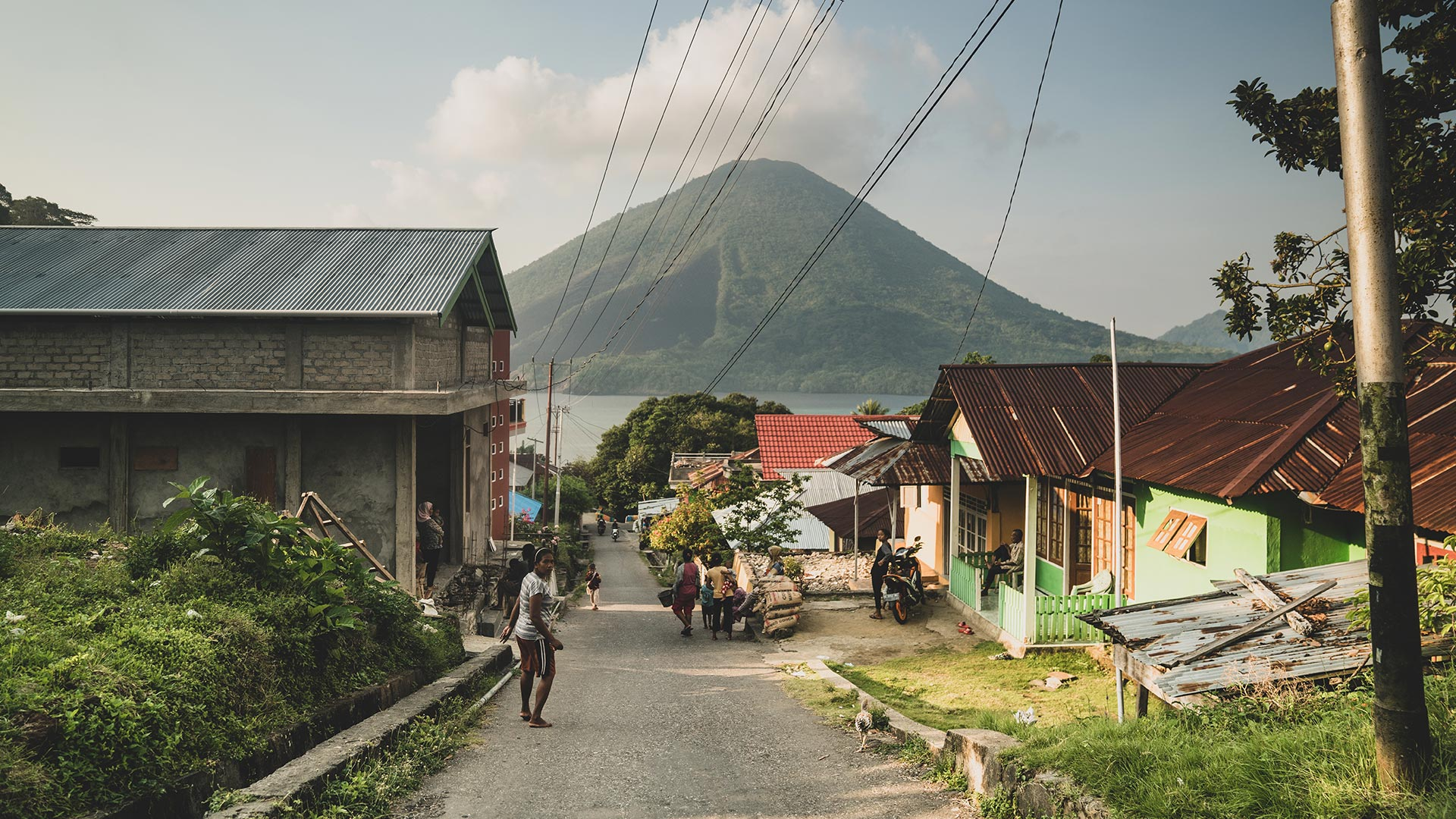 Traditional local village in the Spice islands with a spectacular view of the volcano