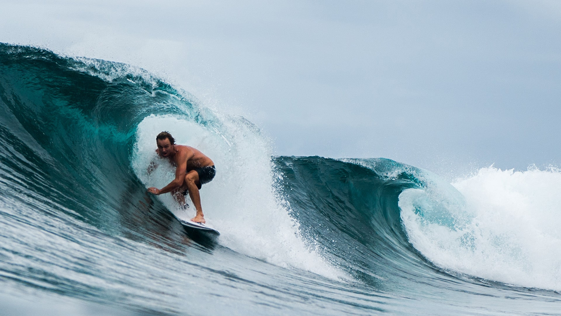 Kudanil Explorer surfer Harrison Roach barreled in tropical wave in Papua