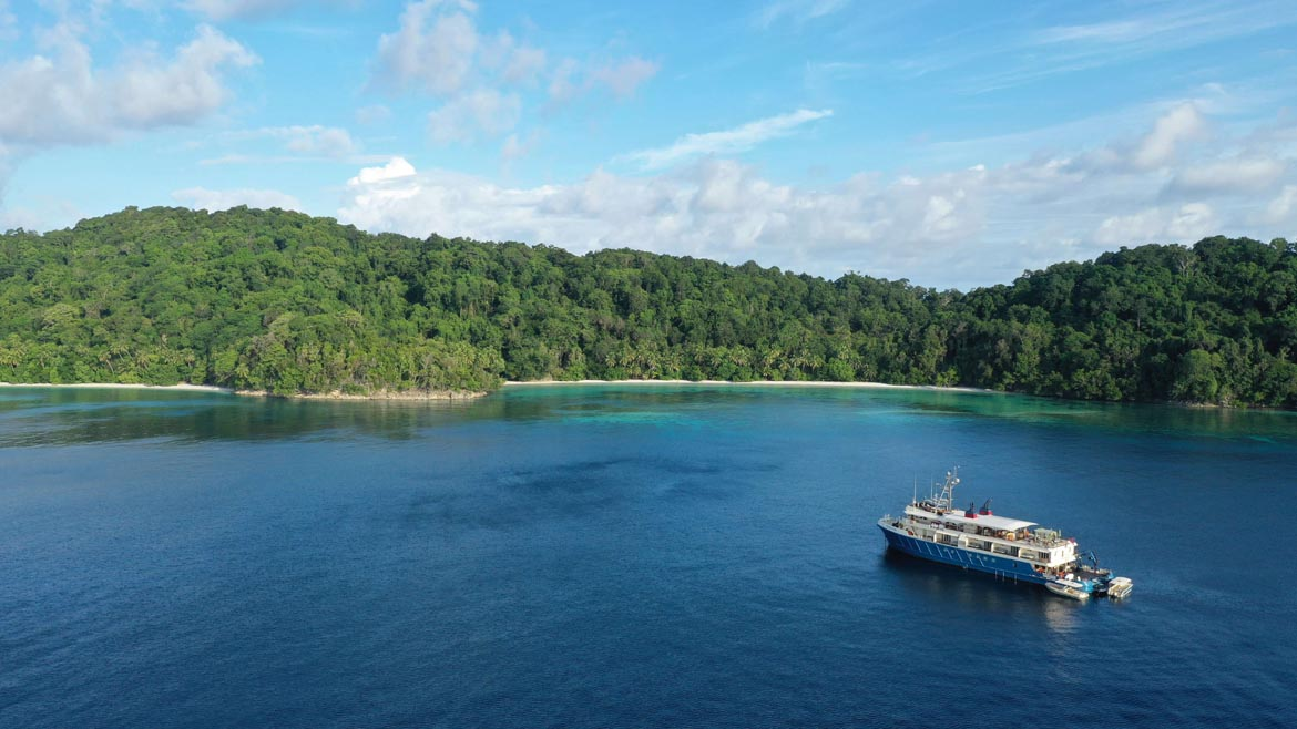 Kudanil Explorer luxury yacht anchored in beautiful Triton Bay in West Papua
