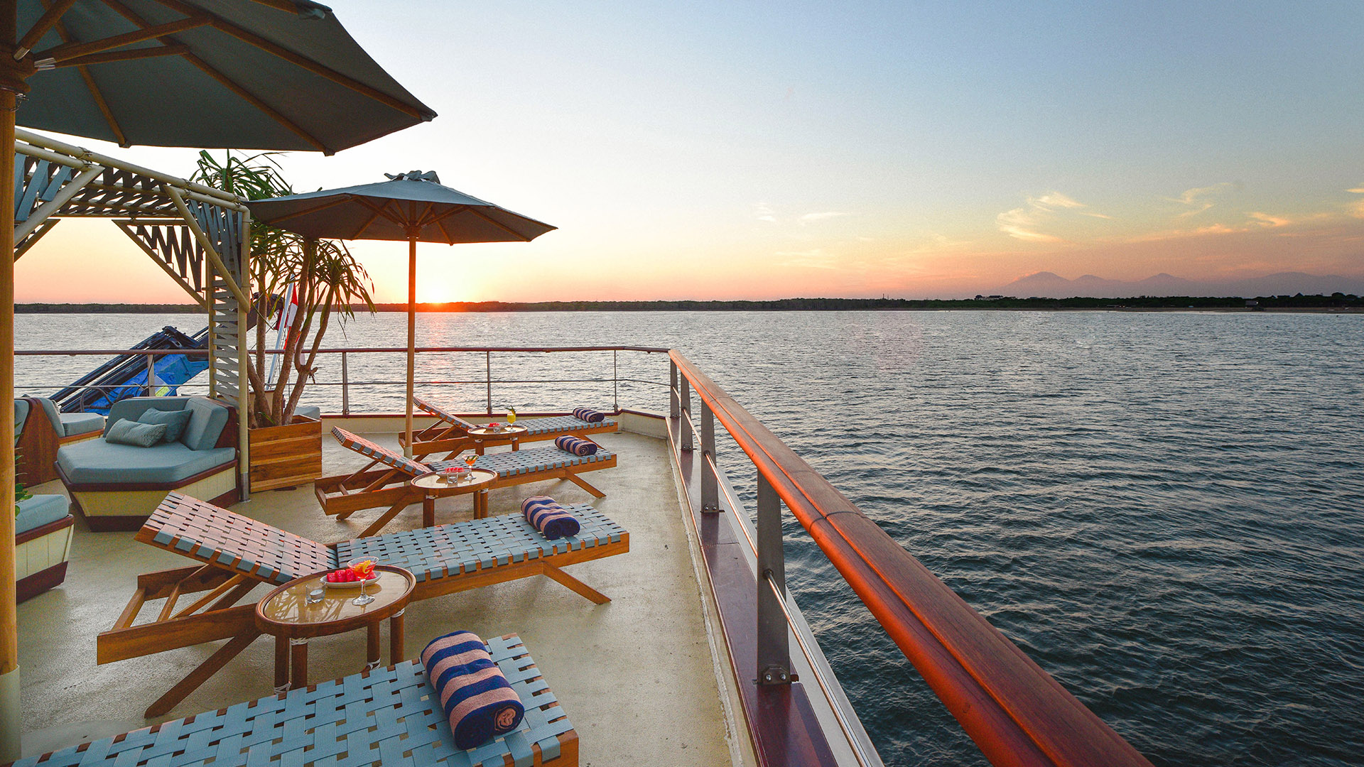 Sunset views from the top deck sunbeds of the Kudanil Explorer yacht